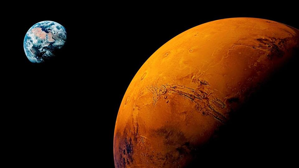 Photo of Mars with Earth in the background, taken from space.